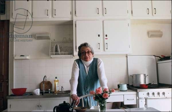 Portrait of Marguerite Duras (pen name of Marguerite Donnadieu) in her kitchen at the hotel Les Les Roches Noires 1986