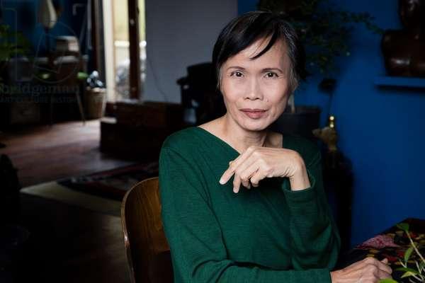 Portrait of Anna Moi (pen name of TRAN Thien Nga) (fashion designer) at her place 2016