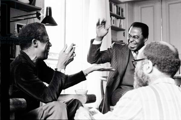 Portrait of James Baldwin (left) and Archie Shepp (sax player) (center) and Ted Joans (trumpeter) (right) 1975