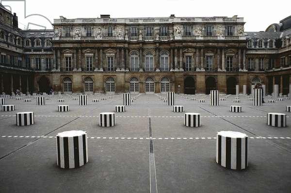 """Art Installation """"les colonnes de Buren"""" in the Palais Royal, Paris, achieved in 1986 (photo)"""