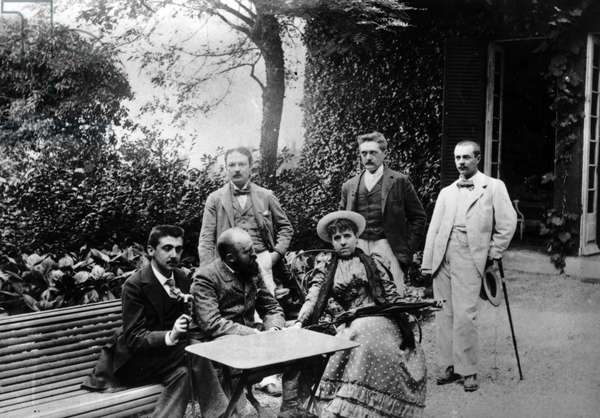Summer 1892, before the Court Brulee in Normandy sitting from left to right: Marcel Proust (1871-1922), Etienne Louis Ganderax (1855-1941) and Genevieve Straus (nee Genevieve Halevy, 1849-1926) - standing on the right: Georges de Porto Riche (Porto-Riche, 1849-1930) and Louis de la Salle.