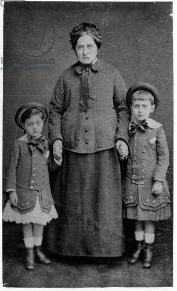 Robert and Marcel Proust surround their paternal grandmother (Virginie Torcheux) in 1877