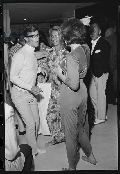 Roddy McDowall, Lauren Bacall, and Shirley MacLaine at a Malibu house party, 1965 (b/w photo)