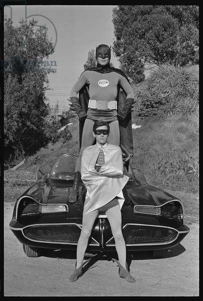 Batman and Robin and Batmobile on the set of the 'Batman' TV series, 1966 (b/w photo)