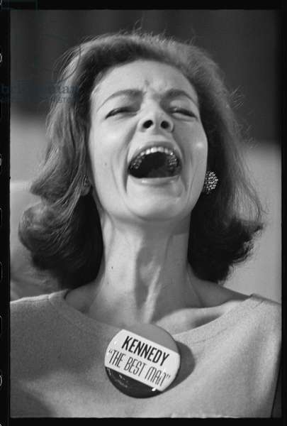 Lauren Bacall wearing 'Kennedy The Best Man' pin badge on election night, 1960 (b/w photo)