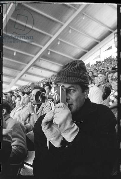 Tony Curtis with Leica camera at the Winter Olympics, Squaw Valley, California, 1960 (b/w photo)