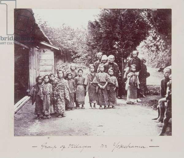 People in a village, Yokohama, 1861-66 (b/w photo)