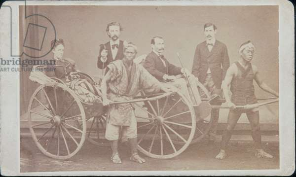 Group of Four Foreigners with two Rickshaws and Rickshawmen, 1872 (b/w photo)