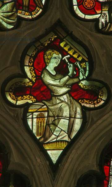 A window in the Lady Chapel depicting a musician angel with bells (stained glass)
