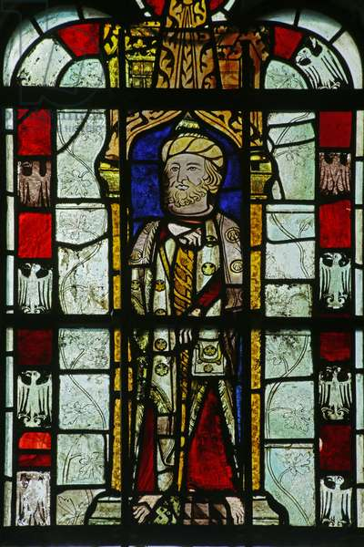 Figure with unusual headgear and heraldic eagles (stained glass)
