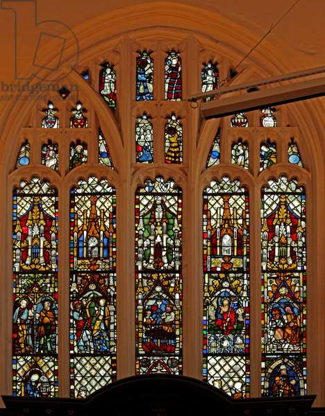 Window Ew depicting the east window with some 14 century panels from the previous church (stained glass)