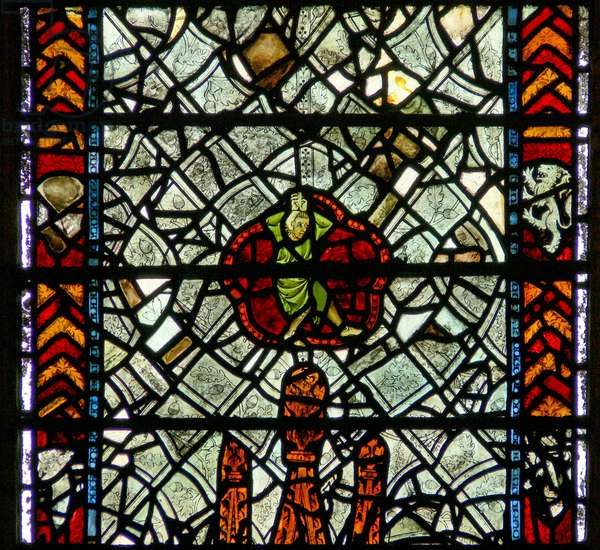 Window w39 depicting a figure (bizarre!) amid grisaille (stained glass)