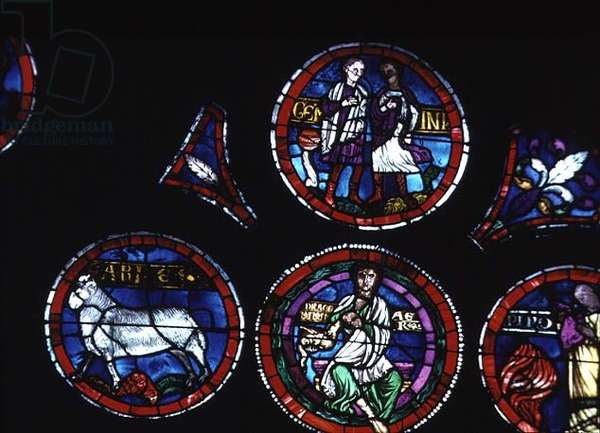 Zodiac signs Aries, Gemini and the element air; detail of rose window (with some 19th century restoration)
