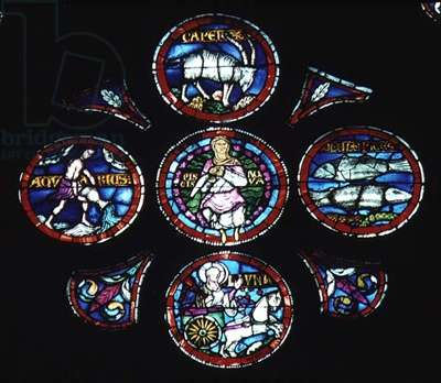 Detail of the Rose Window that depicts an Imago Mundi. This Shows the element Water, Capricorn, Aquarius, Pisces and the Moon being drawn across the sky in a chariot