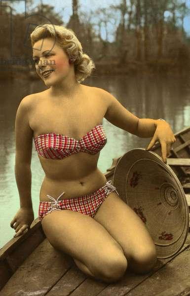 Woman posing in bikini and with an Asian hat, 1930