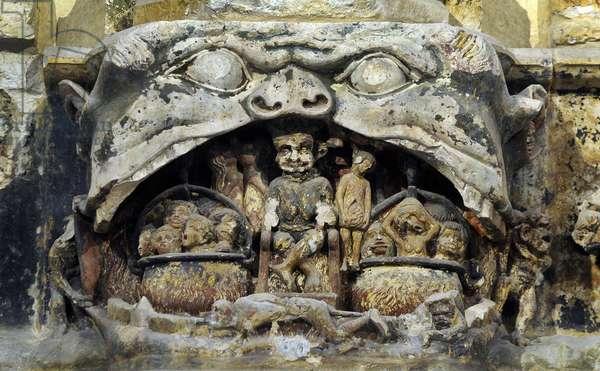 Detail of the 14th century polychrome carved stone altarpiece, cathedrale Saint-Just (Saint Just) de Narbonne: l'enfer - medieval mreligieux art - Photo Patrice Cartier -