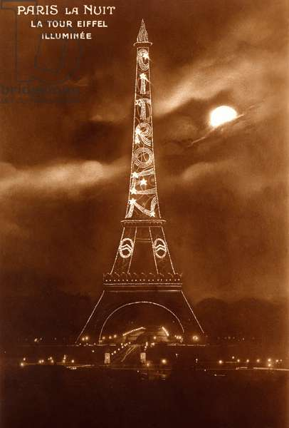 """Paris by night: the Eiffel Tower illuminated with a claim for the Citroen car company. On July 4, 1925, at the International Exhibition of Modern Decorative and Industrial Arts, a structure composed of 250,000 light bulbs illuminated for 40 seconds in front of a marvellous crowd. This operation carried out by a certain Ferdinand Jacopozzi cost the trifle of 125,000 francs. It will be renewed more times over the next 10 years, the structure has the glory of the """"herringbone mark"""" remaining in place on the tower. IMPORTANT: This photo made in 1925 is of course NOT SUBJECT to the current rights on the views of the illuminated Eiffel Tower!"""