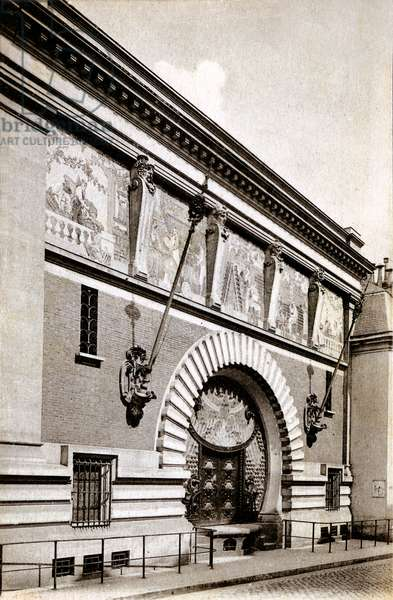 Entrance of the Maison des Champagnes Veuve Clicquot (Clicquot-Ponsardin) with a frieze above the door representing the various stages of wine work, rue de Mars, Reims, France (b/w photo)