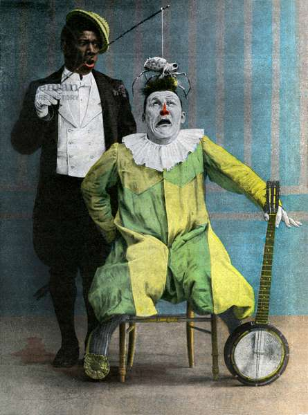 """Photograph of Footitt and Chocolat: The clowns duo of George Footitt (sometimes wrote Footpetit or Footitt, his real name Tudor Hall, white clown, 1864-1921) and Rafael Padilla (1866 or 1868-1917), nicknamed """"Chocolate"""" (clown negre) in one of their comic show - sketch """""""" was for laughing"""""""""""""""""""""""" with banjo and araignee - circus - black and white -"""