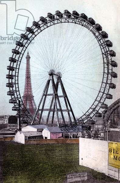 Paris, France, at the beginning of the 20th century: The Eiffel Tower seen through the Grande Wheel - postcard (colorisee d'epoque) sent in 1912 -