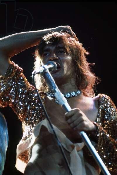 British rock singer Rod Stewart (Sir Roderick David Stewart) in concert with rock band The Faces in 1972 - live microphone - Singer Rod Steward (born 1945) in concert 1972 with rock band The Faces - photo Urve Kuusik -