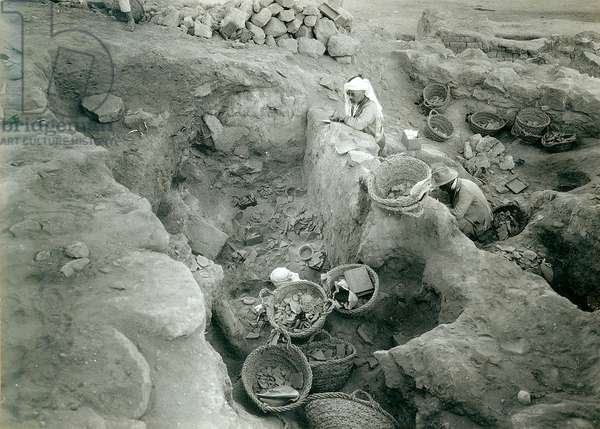 Garstang recording excavated Middle Bronze Age (2000-1500 BC) store rooms, 1930 (b/w photo)