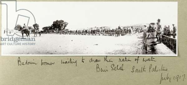 Bedouin women waiting to draw their ration of water, Beni Saleh, July 1917 (b/w photo)