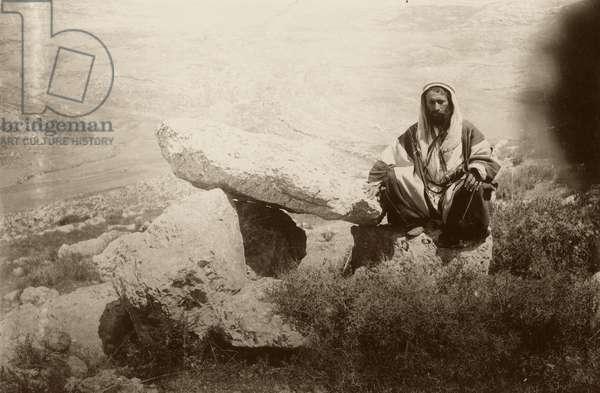 Dolmen and man, west of Hesban (Heshban), 1881 (b/w photo)