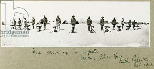 Guns drawn up for inspection on the beach, Khan Yunis, September 1917 (b/w photo)