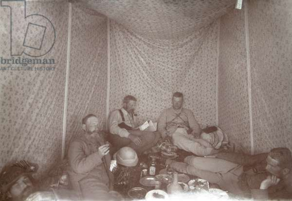 Members of the Arabah Survey expedition relaxing in their tent, 1883 (b/w photo)