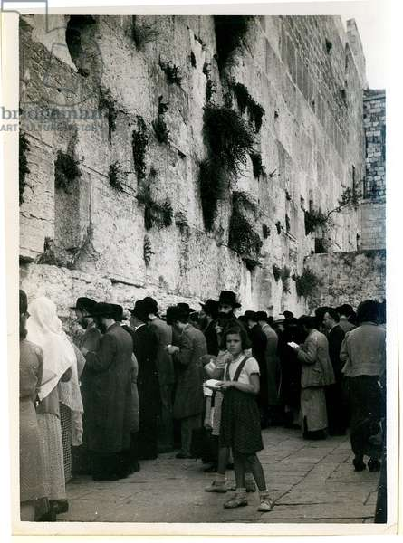 Men at prayer at the Western Wall in Jerusalem, with a girl in the foreground, c.1944-46 (b/w photo)