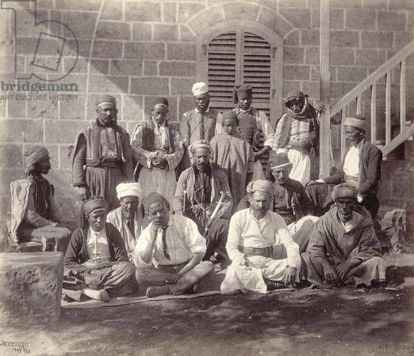 Group of fifteen camp attendants to the Prince of Wales's party at Beirut, 1862 (b/w photo)