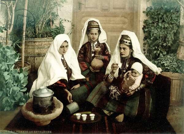 Group of Arab women from Bethlehem drinking coffee, c.1880-1900 (photochrom)