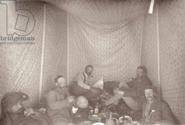 Members of the Arabah Survey expedition in their tent, 1883 (b/w photo)