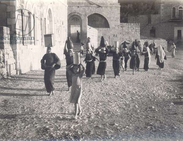 Group of girls collecting water from the spring at Ain Karim, c.1944-46 (b/w photo)