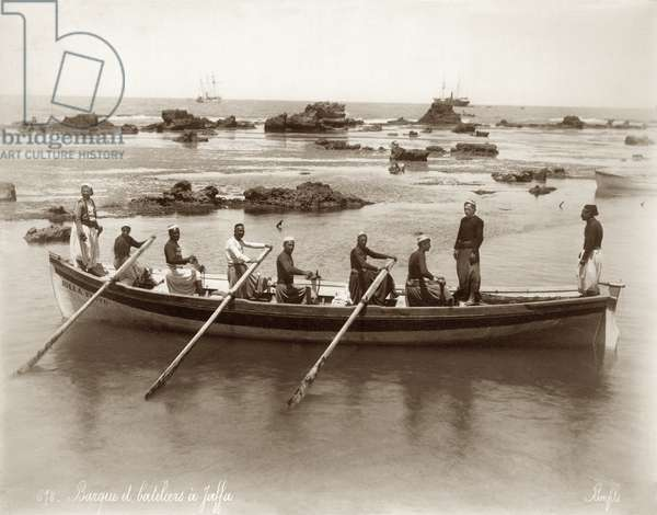 View of a boat and harbour rocks at Jaffa, c.1867-96 (b/w photo)