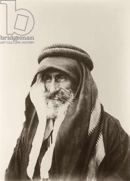 Portrait of Sheikh Khalil Senaah (against a wall background) at Kerak, c.1895-99 (b/w photo)