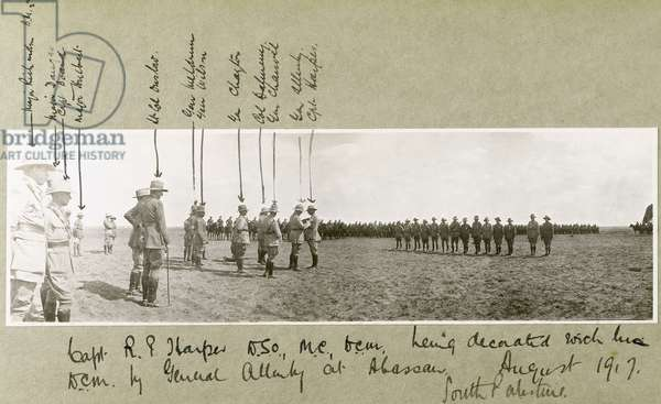 General Allenby decorating Captain Harper with the D.C.M. at a ceremony at Abassan, South Palestine, August 1917 (b/w photo)