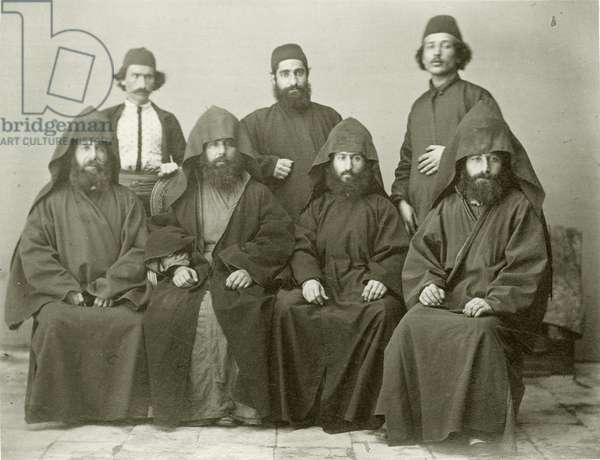 Group of 4 Armenian priests and 3 others in the courtyard at the Mediterranean Hotel, Jerusalem, 1867 (b/w photo)