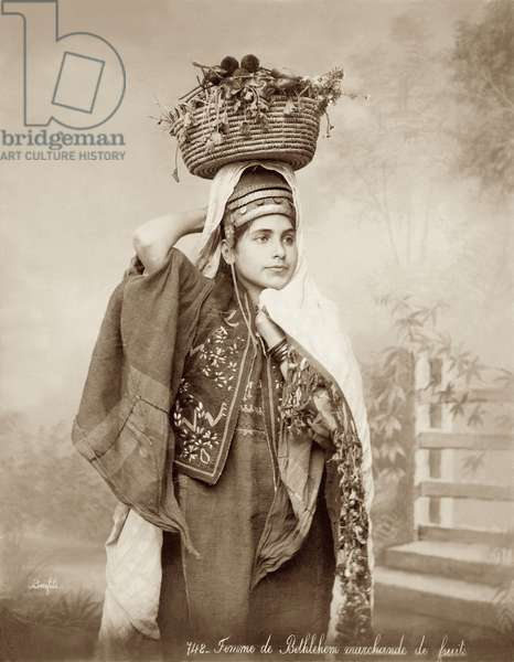 Woman with a basket of fruit on her head, c.1867-98 (b/w photo)