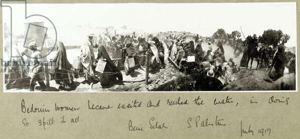 Bedouin women rushing for their water ration, Beni Saleh, July 1917 (b/w photo)