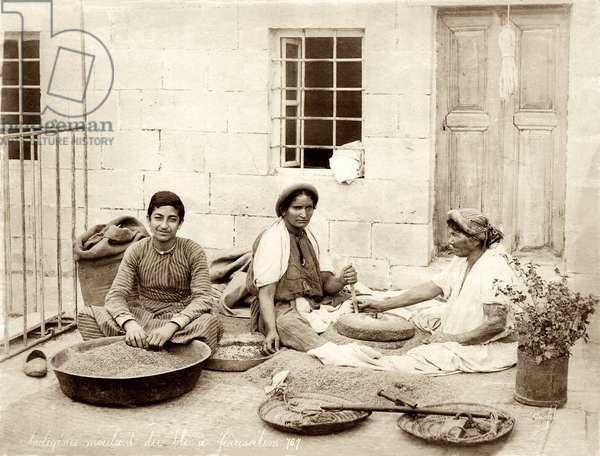 Grinding wheat in Jerusalem, c.1867-98 (b/w photo)
