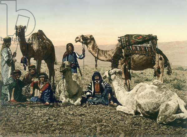 Western travellers dressed as Bedouins and their guides with their camels in the Jordan Valley, c.1880-1900 (photochrom)