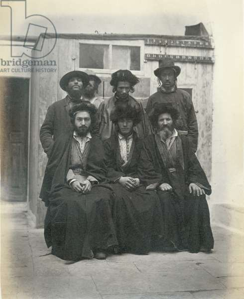Group of 7 Polish Jews in the courtyard of the Mediterranean Hotel, Jerusalem, 1867 (b/w photo)