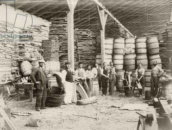 Interior of a casks factory at Zichron Yaacov with workers, c.1898-1900 (b/w photo)