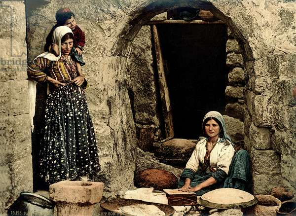 Lebanese women making bread in front of their house, c.1880-1900 (photochrom)