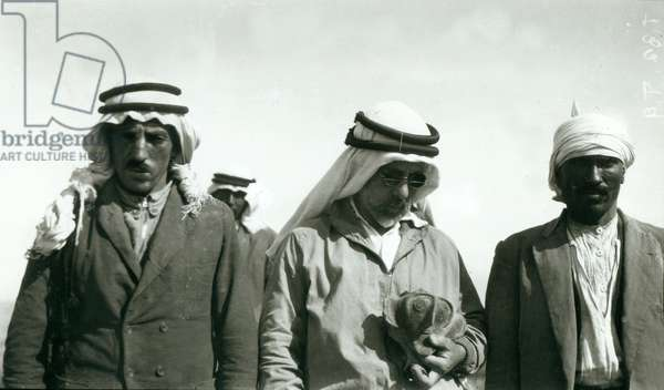 Garstang (holding chalice) and two members of the excavation team, 1930 (b/w photo)
