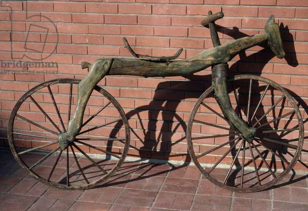 Draisienne, ancestor of the bicycle, 19th century (photo)
