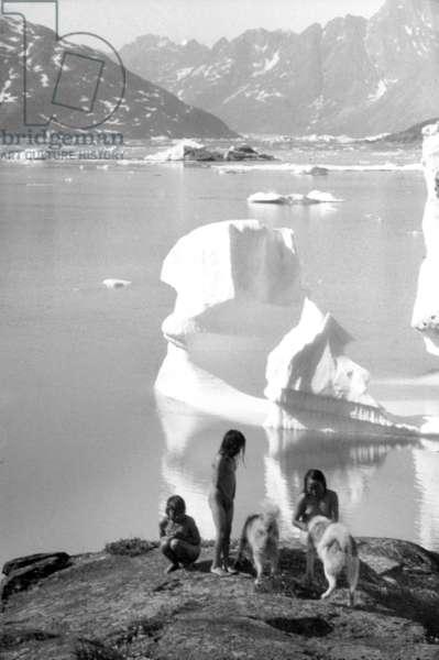 Inuit children bathing in the fjord of Kangerdlugssuatsiak, Greenland, Autumn, 1936 (b/w photo)