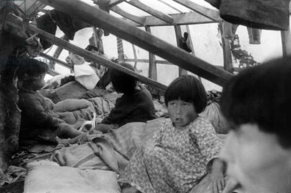 Inuit children in a tent, during polar expedition in Greenland, Kangerdlugssuatsiak, August, 1936 (b/w photo)